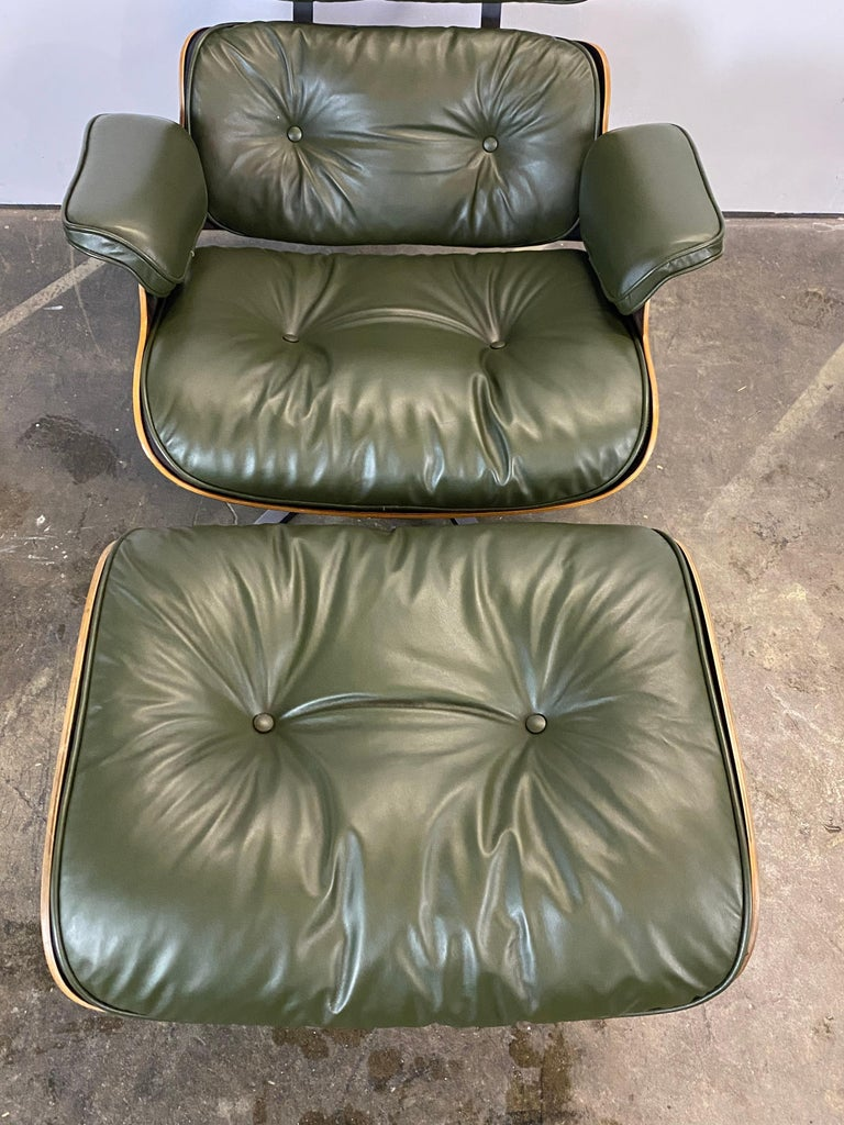 Not a color you see often! A classic Eames lounge chair and ottoman with vintage wood and metal components outfitted in brand mew leather cushions in Avocado shade. Signed and guaranteed authentic Herman see Miller Eames production. Everything works