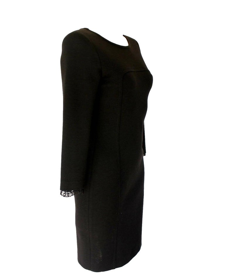 Exclusive and gorgeous EMILIO PUCCI little black dress with lace detail on back Made of finest black wool mix Closes with side zipper 3/4 sleeves with lace detail Dry Clean only 98% Wool, 2% Elastan Made in Italy Label size IT 42 fits best US 6-8