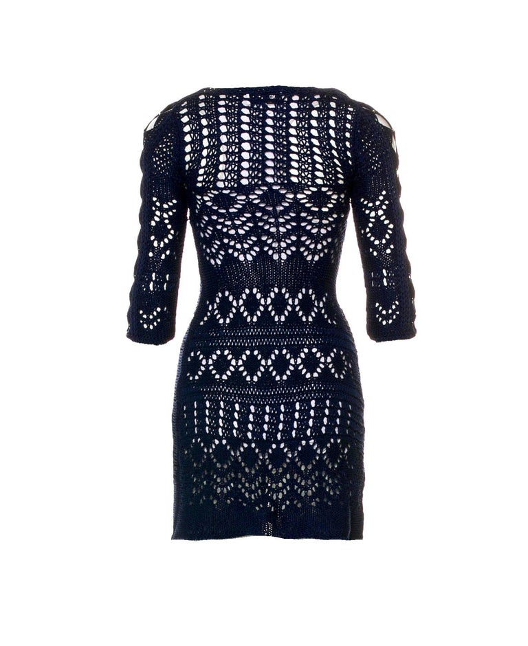 Beautiful Emilio Pucci Mini Dress     3/4 sleeves with decorative hardware pins     Midnight blue color     Simply slips on     Slim fit     Made in Italy Size IT 42 Retails for 1399$ plus taxes