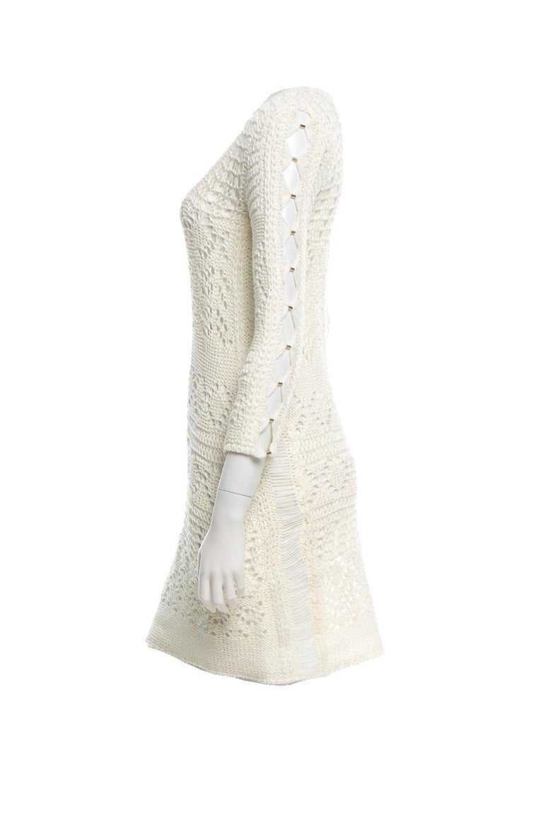 Beautiful Emilio Pucci Mini Dress     3/4 sleeves with decorative hardware pins     Ivory color     Simply slips on     Slim fit     Made in Italy Fits US Small / US 6  The last two PUCCI campaign picture show the style for your reference, the