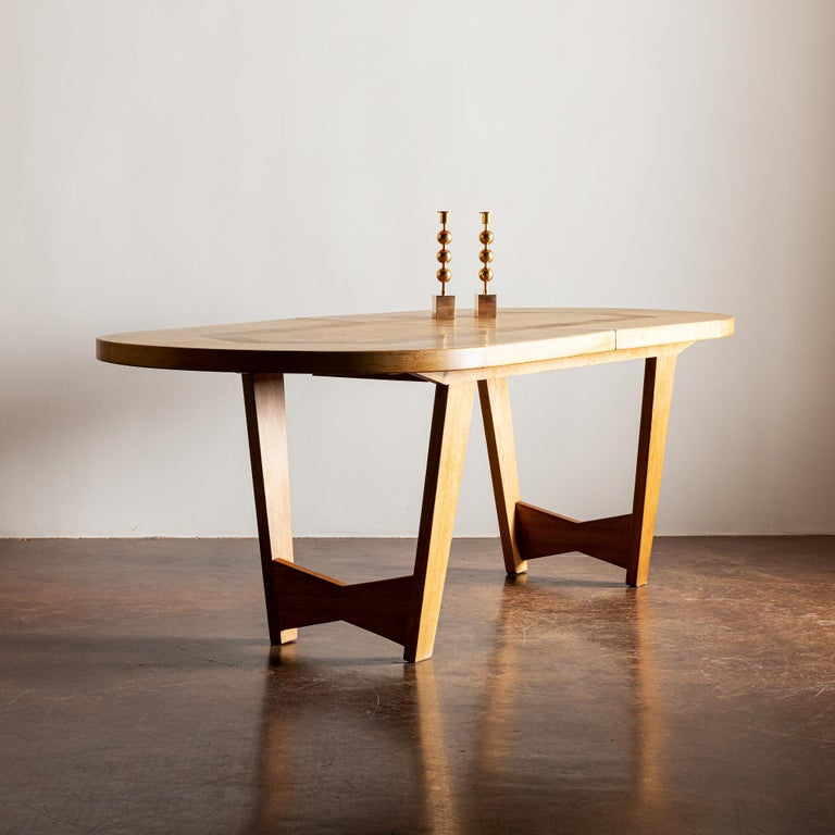A stunning Ardennes dining table in oak by Guillerme et Chambron with two extension leaves.  Measures 110 inches with both leaves.