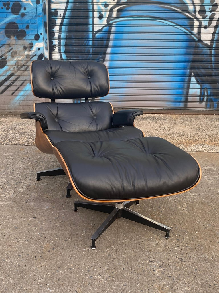 One of the most beautiful Eames lounge chair/ottoman sets we have ever encountered. Sweeping and beautiful Brazilian rosewood grains. Original leather in good condition. No missing buttons. Even color. Signed and guaranteed authentic Herman Miller