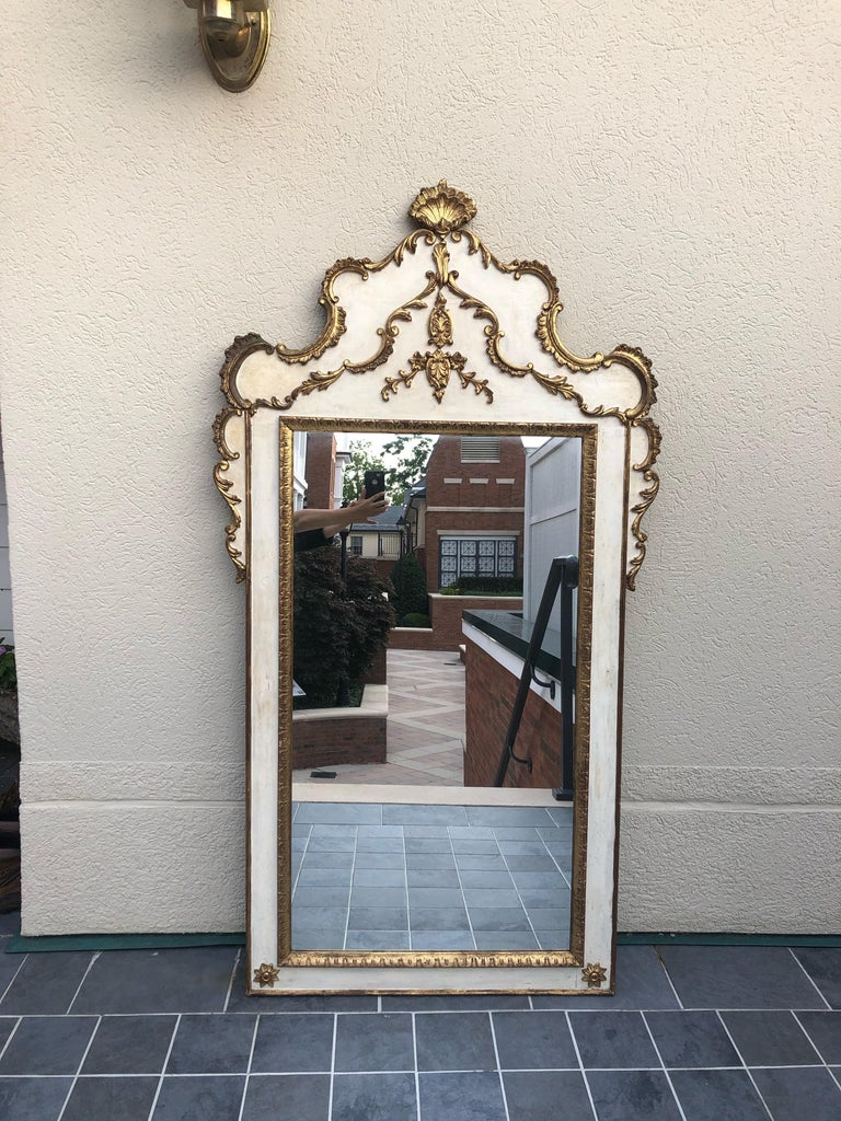 """Striking large Gustavian style painted and giltwood mirror having lovely curved top with shell decoration at the top.  Crown itself measures 18.5"""" high x 34"""" wide Actual mirror alone measures- 22"""" wide x 41"""" high."""