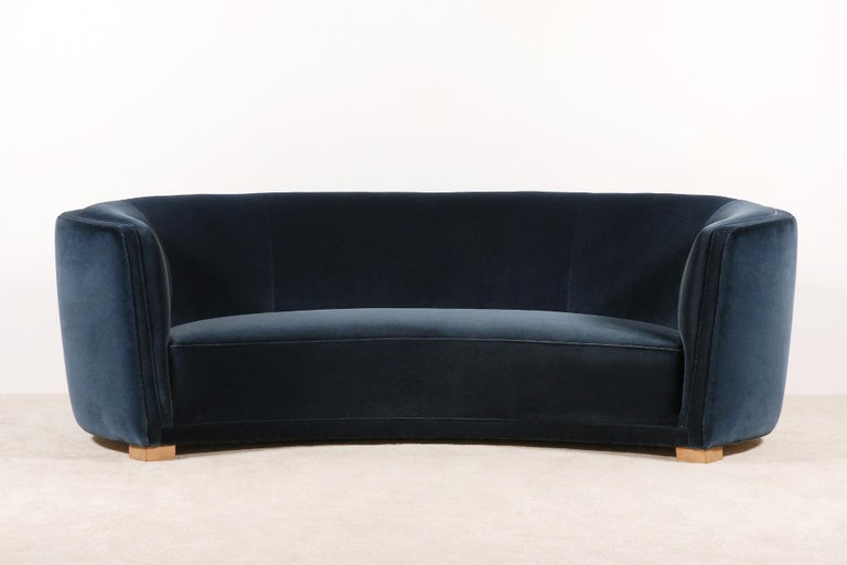 Exceptional and unique piece. Large three-seat curved sofa manufactured in Denmark during the 1930s. Lovely shape and curves. Very comfortable seat. Natural color waxed beech feet.  This sofa has been fully restored and newly upholstered in the