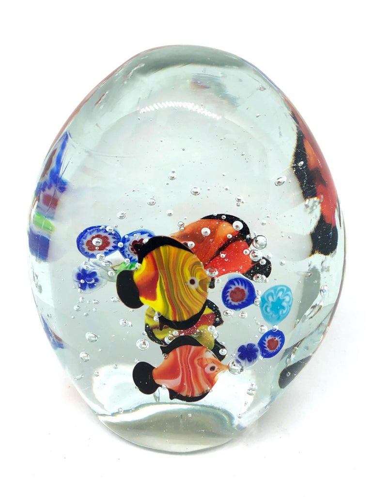 Beautiful Murano hand blown aquarium Italian art glass paper weight. Showing some multicolored fishes, floating on controlled bubbles. Colors are a blue, orange and clear. A beautiful nice addition to your desktop or as a decorative piece in every