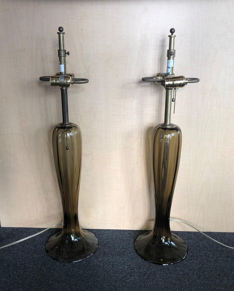 A simply gorgeous pair of Murano art glass trumpet lamps in a smoky topaz color. The lamps are quite tall, slender and ribbed lamp with a splayed foot. The height is adjustable from 29