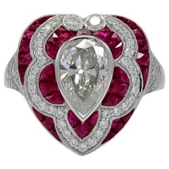 Gorgeous Platinum 1.30 Carat Pear Shape Center Diamond and Ruby Ring