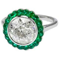 Gorgeous Platinum 2.88 Carat Center Diamond and Emerald Ring