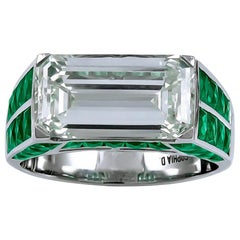 Gorgeous Platinum 3.58 Carat Emerald Cut Center Diamond and Emerald Ring