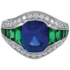 Gorgeous Platinum Ring with Emerald, Diamond, and Sapphire Center