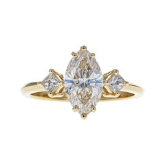 Gorgeous Three-Stone Diamond Engagement Ring with Marquise Diamond Center