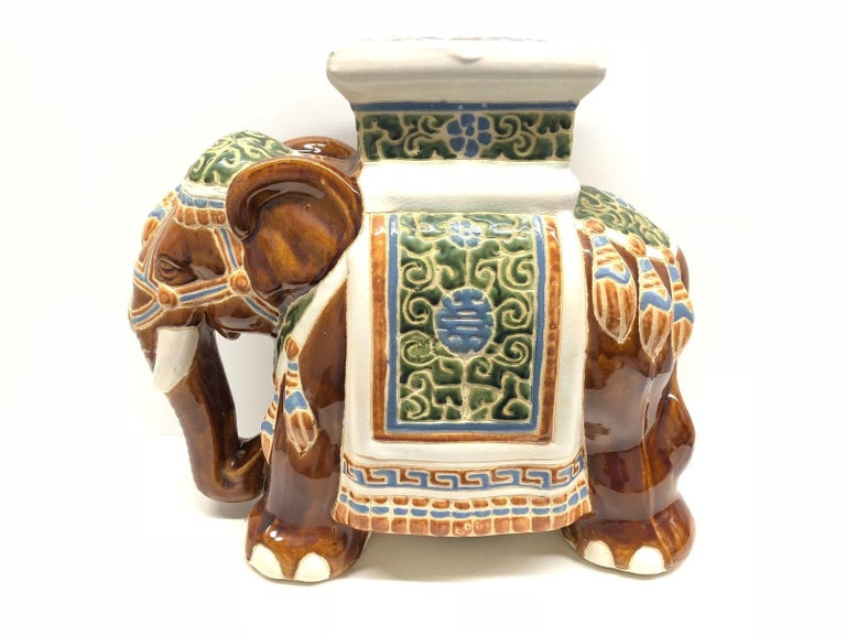 Mid-20th century glazed ceramic elephant garden stool, flower pot seat or side table. Handmade of ceramic. Nice addition to your home, patio or garden.