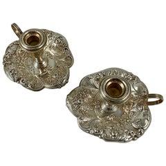 Gorham Sterling Silver Floral Repoussé Chambersticks, circa 1920-1930, a Pair