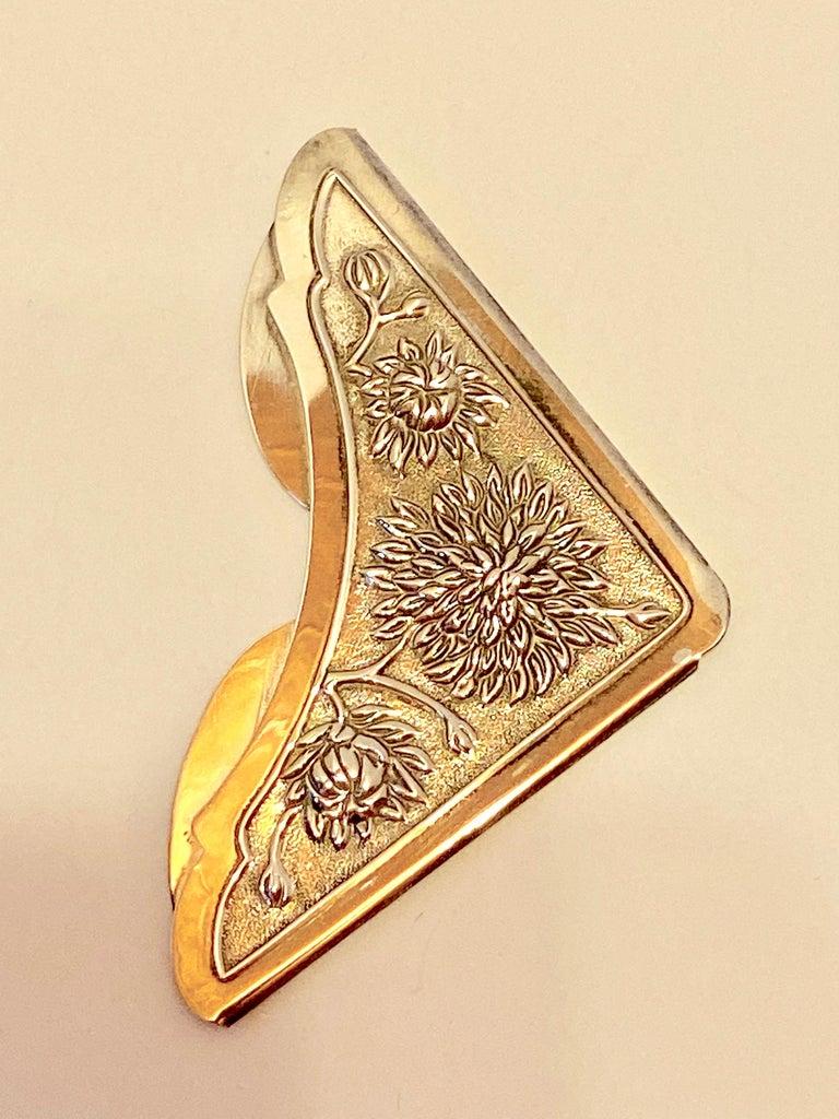 Gorham's wonderfully detailed Victorian sterling silver Bursting Floral bookmark entails multi bursting florals in bloom. This bookmark measures 1 7/8 inches by 1 7/8 inches. Diagonally, it measures 2 5/8 inches. The backside is etched