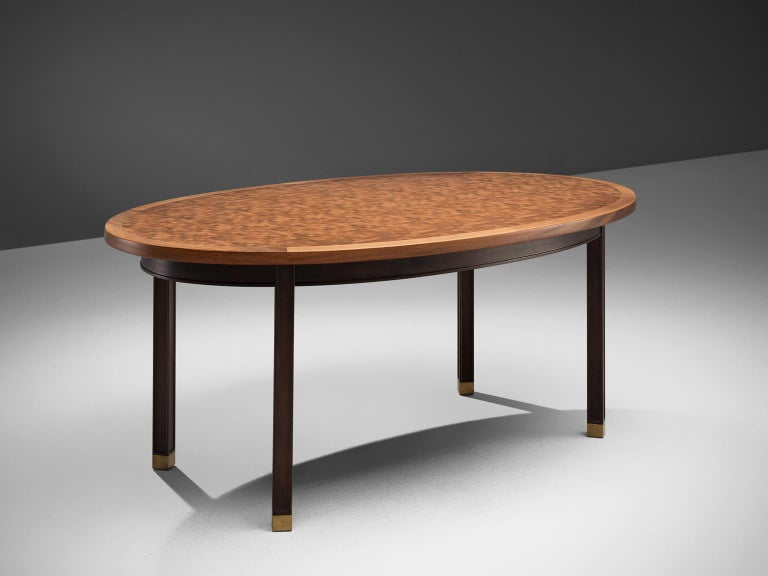 Gorm Lindum, checked oval dining table, mahogany and brass, Denmark, 1970s.   This inlaid centre table by the Danish architect Gorm Lindum has mosaic structured tabletop, that consist of cubical pieces end-grain mahogany wood. These pieces vary both