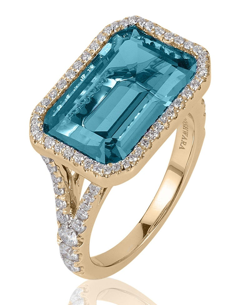 Blue Topaz East-West Emerald Cut Ring With Diamonds in 18K Yellow Gold, From 'Gossip' Collection  Stone Size: 10 x 15 mm  Gemstone Approx Wt: Blue Topaz- 9.70 Carats  Diamonds: G-H / VS, Approx Wt: 0.78 Carats