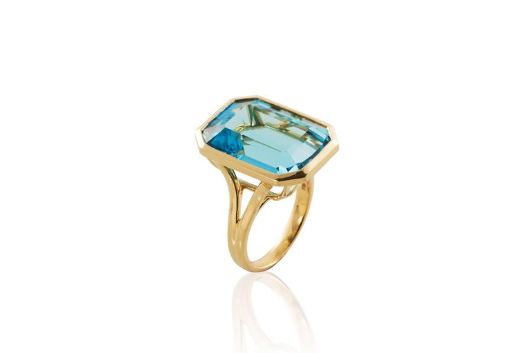 Blue Topaz Emerald Cut Ring in 18K Yellow Gold, from 'Gossip' Collection Stone Size: 14 x 20 mm Gemstone Approx. Wt: Topaz- 25.10 Carats