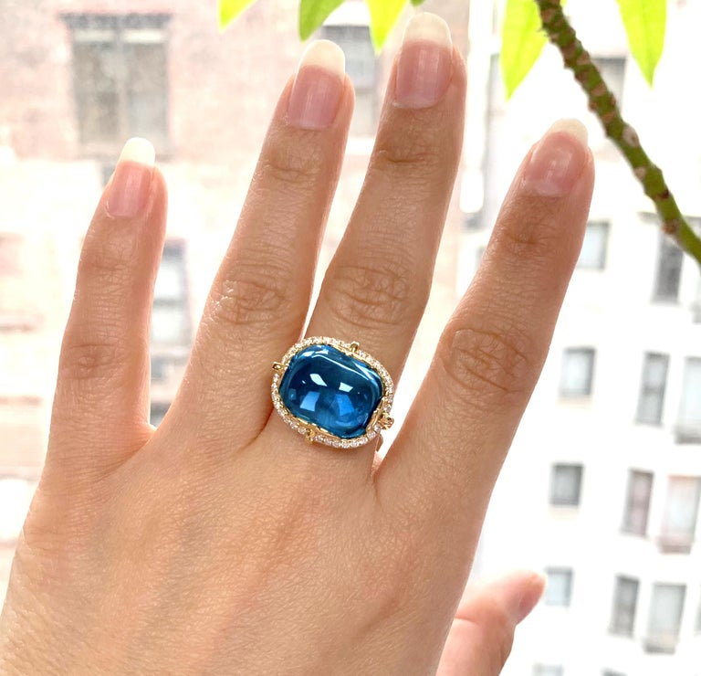 London Blue Topaz Cushion Cabochon Ring in 18K Yellow Gold with Diamonds, from 'Rock 'N Roll' Collection. Please allow 4-5 weeks for this item to be delivered.  Stone Size: 16 x 13 mm  Diamonds: G-H / VS, Approx. Wt.: 0.36 Carats