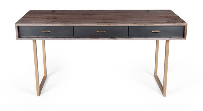 The harmonious mix of materials enhances the beauty of this Gotham desk. The desk features rich oxidized Ambrosia maple wood, a bronze frame, three blackened bronze encased in epoxy resin drawers with black leather lining and hand-sculpted bronze