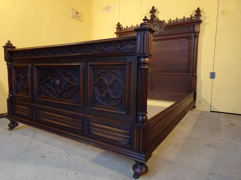 An outstanding quality hand carved walnut Gothic Revival double bed circa 1890 in superb original condition both color and cabinet work this fine bed came from a grand property near Bordeaux France where it had been in the same family for over 120