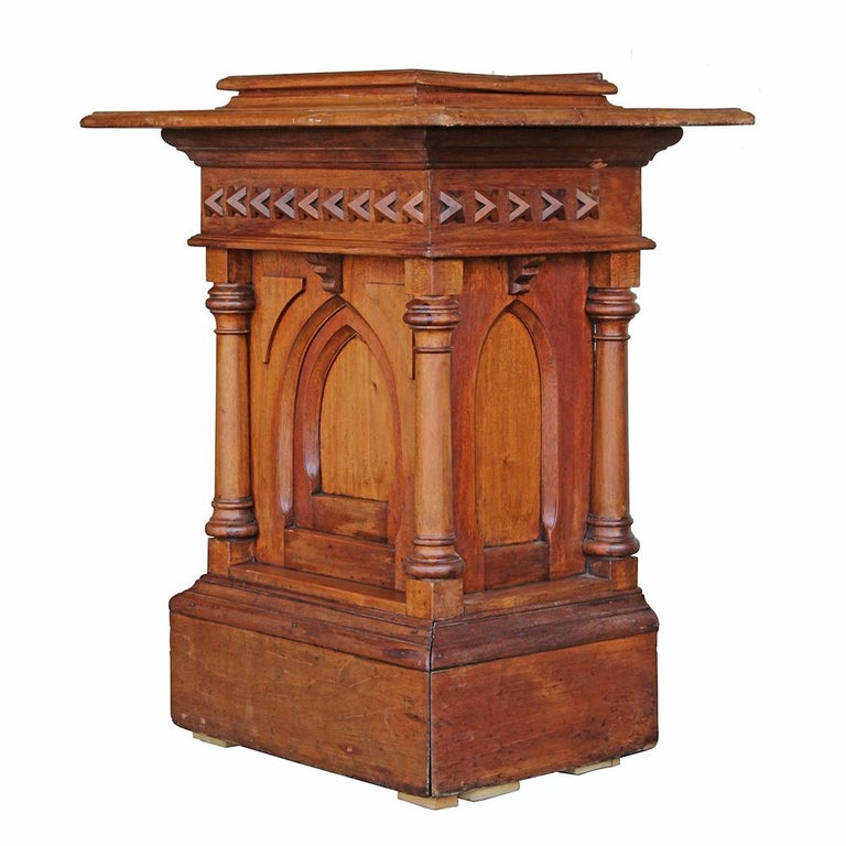 This is a beautifully executed piece of ecclesiastical furniture. Early 20th century, the Gothic Revival styling complements the warm honey hues of the solid oak construction. The carved accents are heavy but very finely executed, contributing to