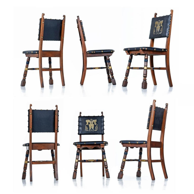 Gothic Revival Style Dragon Motif Brass and Leather Mahogany Oak Dining Set For Sale 1