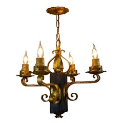 Gothic Style Gilt Wrought Iron and Black Wood Four-Light Chandelier