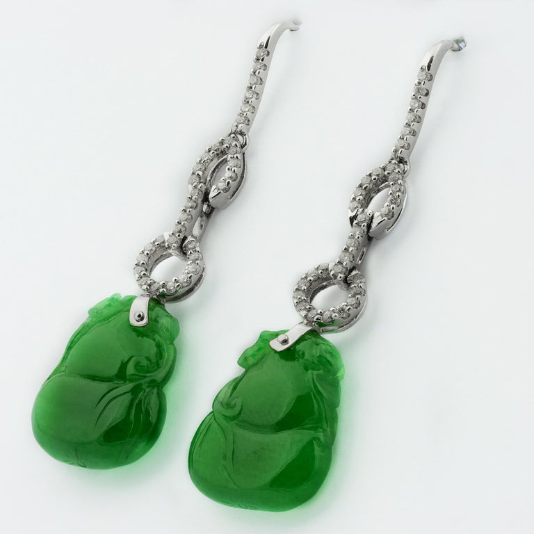 Stunning jade earrings in Gourd Bottle Shape is a symbol of the Chinese Xian immortals. Dangled by various shapes of links, circular and oval white gold links covered in glistening diamonds. The jade is calm and cooling and has a gorgeous sheer