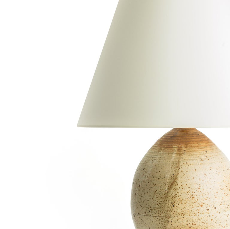 Gourd ceramic table lamp with textured surface.  Custom burnished nickel base fitted to the base.  Wired to US standards with rotary dimmer switch, braided cloth cord.  Shade not included.