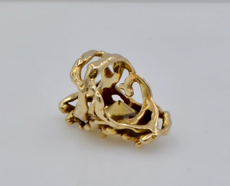 This amazing organic ring was designed and made by the Monterey, California Designer Dorian Grabowski. The 7.25 ct citrine is set in 14k gold freeform branches that intertwine with three dimensional movement . The many tendrils of the beaches