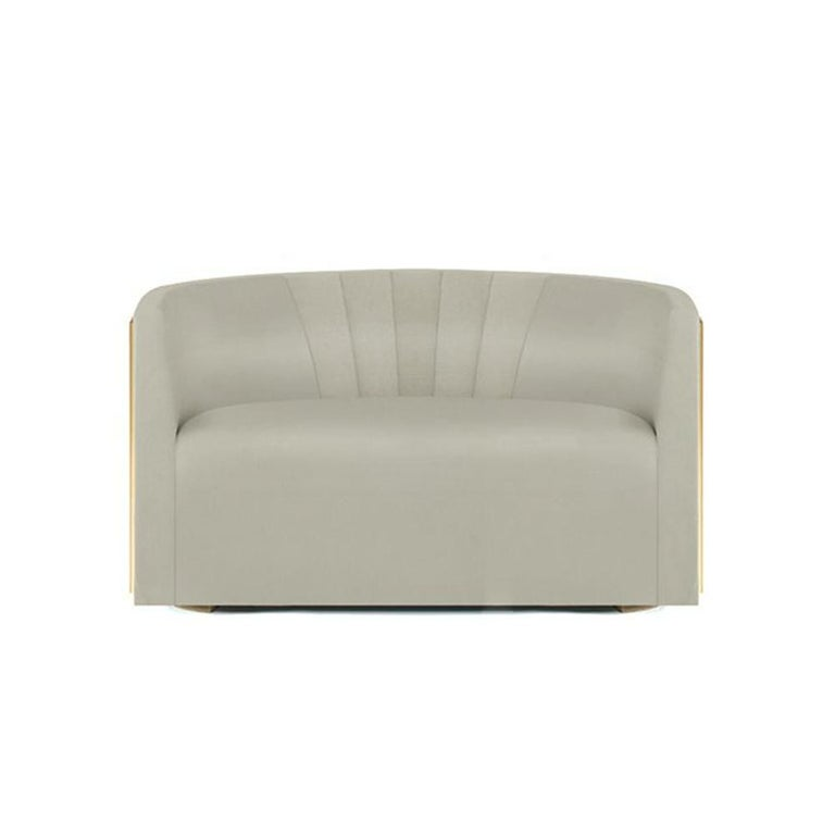 Mansfield is an accent sleek sofa with an undeniable modern elegance. Its rounded forms are a striking addition to any living room, along with the velvet upholstery and the polished brass on the base.  Materials: polished brass and velvet
