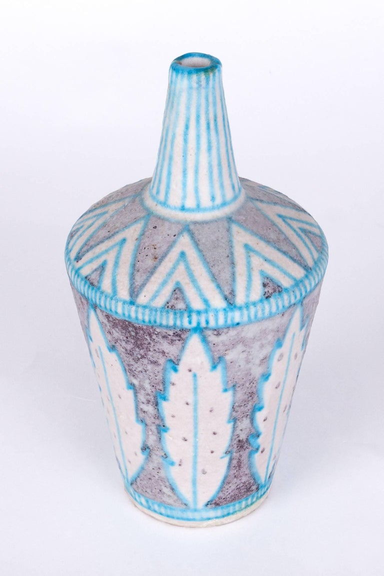 Attractive, lively glazed ceramic C.A.S. Vietri vase in the style of Guido Gambone, with a graceful leaf and imbricated triangle motif. Hand-thrown with blue, brown, and white salt glaze.