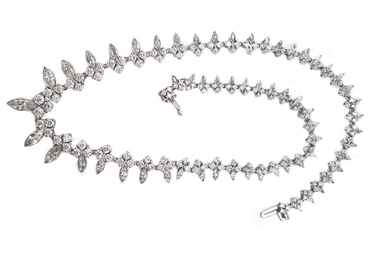 This creative use of graduated marquise and round diamonds make this necklace a unique addition to your jewelry collection! This stunning piece features a total diamond weight of approximately 14ct and is set in 18kt white gold.  H color, VS clarity
