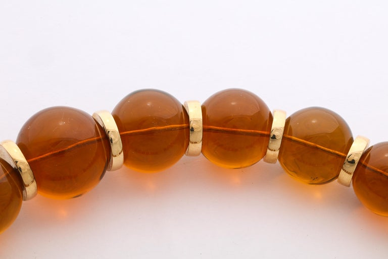 Women's or Men's Graduated Reconstituted Amber and 18 Karat Yellow Gold Rondel Necklace For Sale