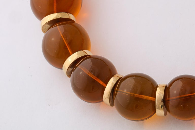 Graduated Reconstituted Amber and 18 Karat Yellow Gold Rondel Necklace For Sale 1