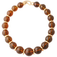 Graduated Reconstituted Amber and 18 Karat Yellow Gold Rondel Necklace