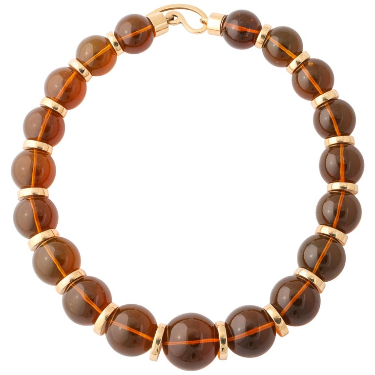 Graduated Reconstituted Amber and 18 Karat Yellow Gold Rondel Necklace For Sale