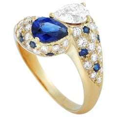 Graff 1.40 Carat Diamond and Blue Sapphire 18 Karat Yellow Gold Ring