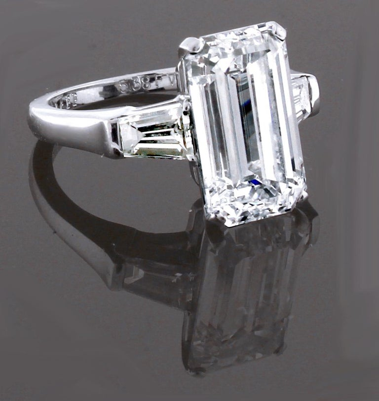 From Graff a  striking and timeless emerald cut diamond ring featuring a remarkable 5.38 carat F, VVS2 diamond. Its sleek, architectural setting featuring baguette cut shoulder diamonds weighing .75 carats complements the strong and sharp lines of