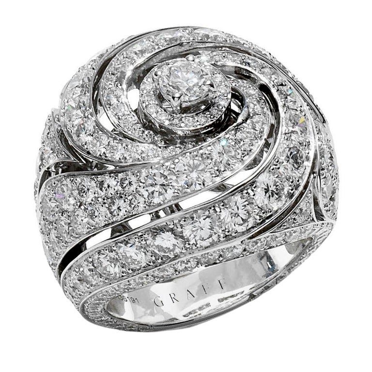 An incredible diamond ring by Graff showcasing 6.83ct of the finest round brilliant cut diamonds set in 18k white gold. This showstopping diamond cocktail ring measures a size 5 1/2 and can be resized if needed.