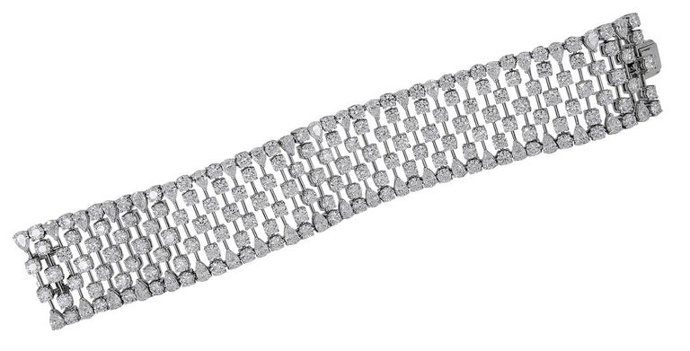 "An 18k white gold bracelet, set with pear-shaped and round brilliant-cut diamonds, weighing approximately 40-42 cts. total DEF color, VVS clarity. Dimensions approx. 7.0″ in length by 1.10″ wide and gold weight approx. 83 grams Stamp ""Graff"" and"