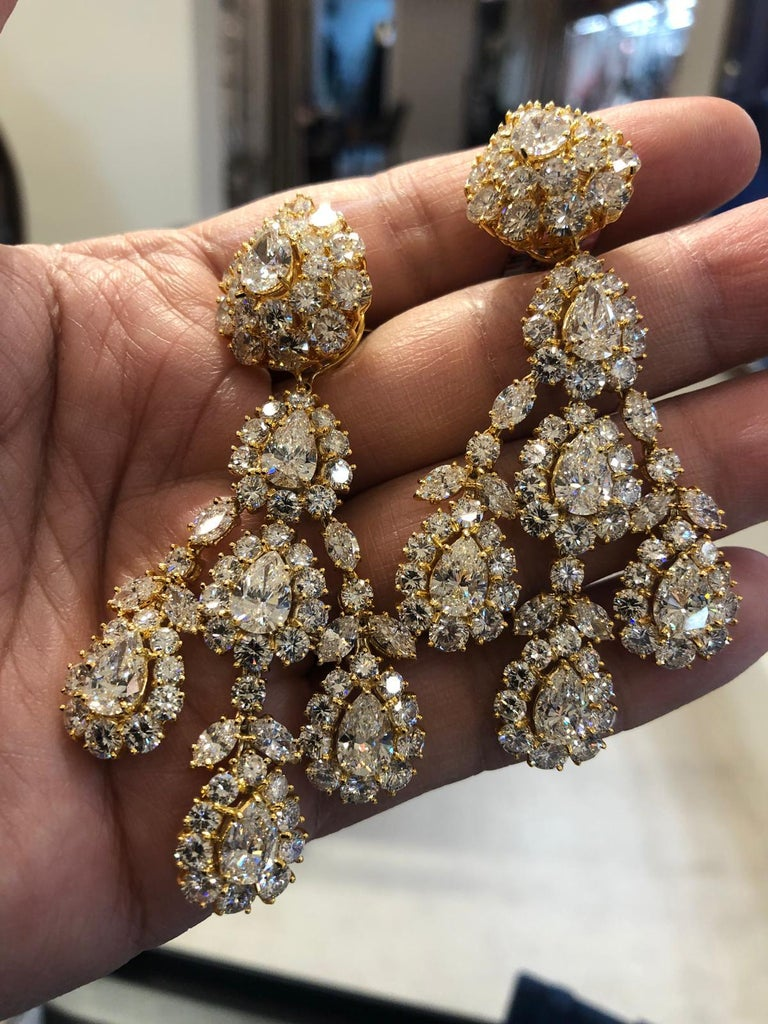 An extravagant pair of chandelier-style ear clips by Graff, exquisitely set with 14 pear-shaped diamonds and round and marquise-shaped diamonds, weighing a total of 47 carats, finely crafted in 18k yellow gold. Signed Graff.  Condition: Good -