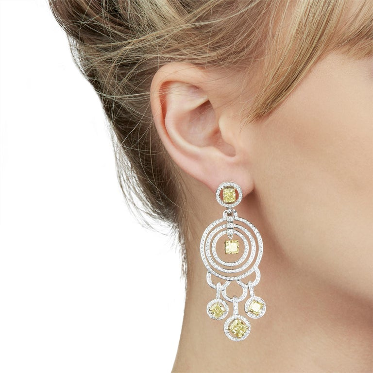 These Statement Earrings by Graff Diamonds feature 10 fancy yellow Diamonds of 8.00ct total and white Diamonds of approximately 2.00ct total, made in 18k White Gold. These Earrings have secure omega backs. Complete with Graff Diamonds Box.