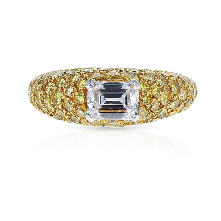 A chic emerald-cut white diamond and yellow diamond bombe ring, by Graff. This ring can be worn in both casual and formal environments. It is set with one E-Color, VVS1-Clarity, Emerald-Cut Diamond, weighing 0.80 carats, accented with 76 round