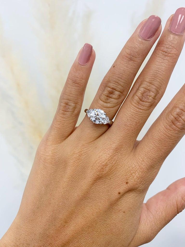 Round Cut Graff GIA Certified 1.61 Carat Round Brilliant Diamond Three-Stone Ring For Sale