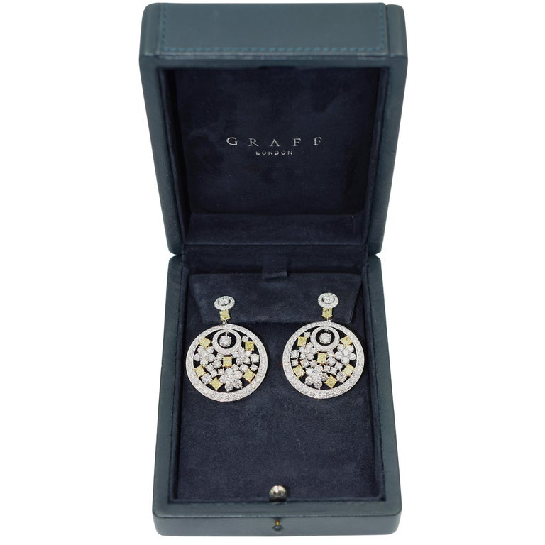 Graff Pair of  Diamond and Fancy Colored Diamond Pendant- Ear-clips This pair of earrings is topped by 2 round diamonds encircled by round diamonds, joined by 2 rectangular modified brilliant yellow diamonds, suspending large round diamond-set white