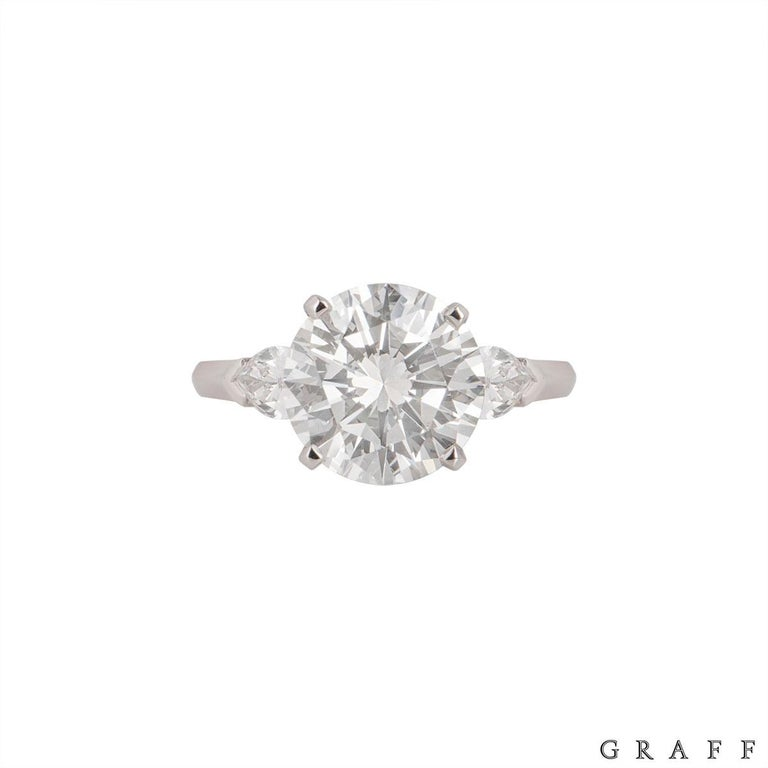 A stunning diamond ring by Graff from the Promise collection. The ring comprises of a round brilliant cut diamond with a single pear shaped diamond on each side in a claw setting. The round brilliant cut diamond has weight of 4.04ct, I colour and
