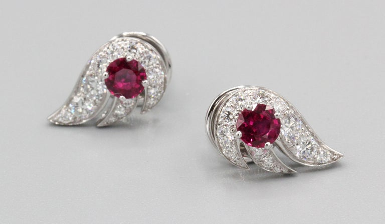 Fine pair of ruby and diamond earrings by Graff.  Set in 18k white gold.   Hallmarks: Graff, AU750, reference numbers, English gold assay mark