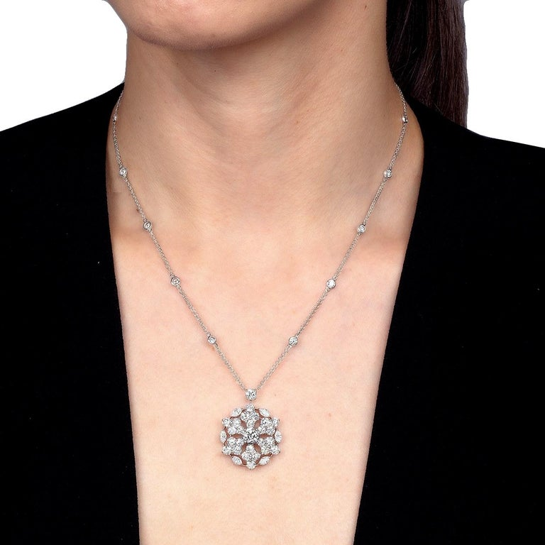 A magnificent diamond pendant necklace by Graff showcasing a Snowflake motif adorned with marquise and round brilliant cut diamonds. Throughout the chain there are diamond stations, the total carat weight measures 6.67ct. The central diamond