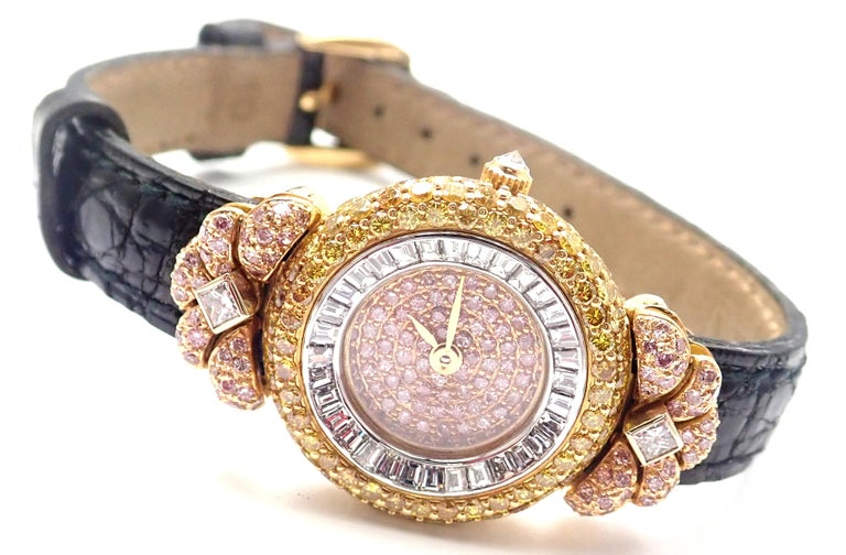 18k Yellow Gold White, Pink and Yellow Diamond Ladies Wristwatch by Graff. With Round Pink diamond dial Pink, yellow and white diamonds Round brilliant cut, 2 princess cut and emerald cut diamonds. Details:  18k Yellow gold case with a black leather